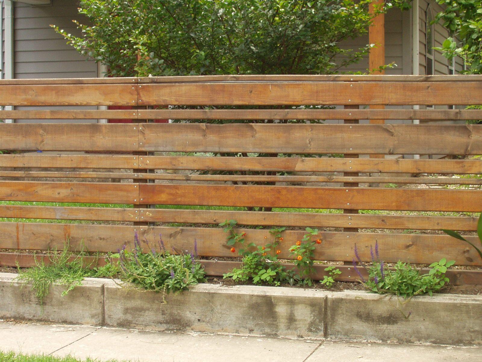 Horizontal wood slat fence with concrete base totally different horizontal wood slat fence with concrete base totally different feel than the traditional picket fence baanklon Choice Image