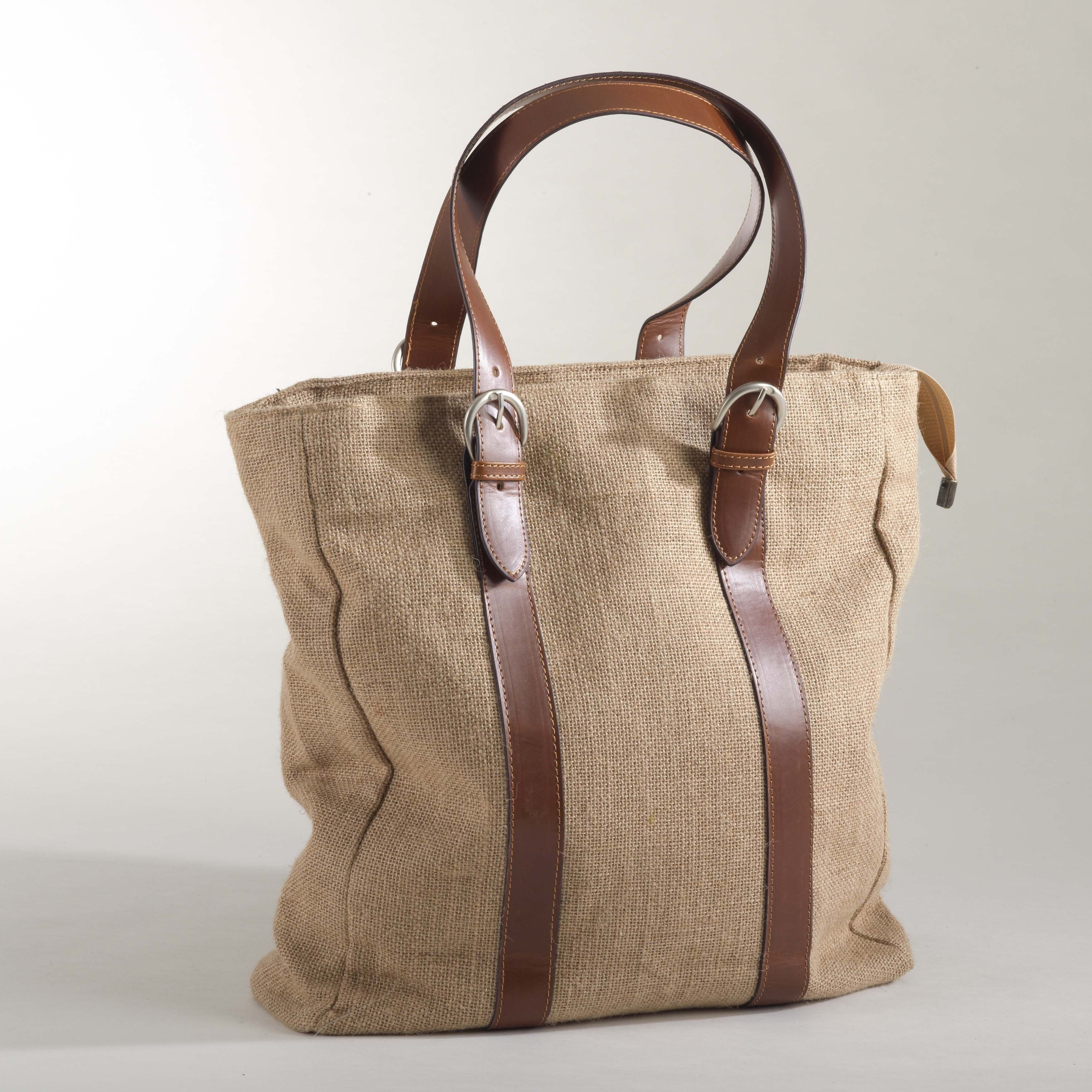 8192cd95c Dress up any outfit with this burlap design tote bag. Available in designer  natural.