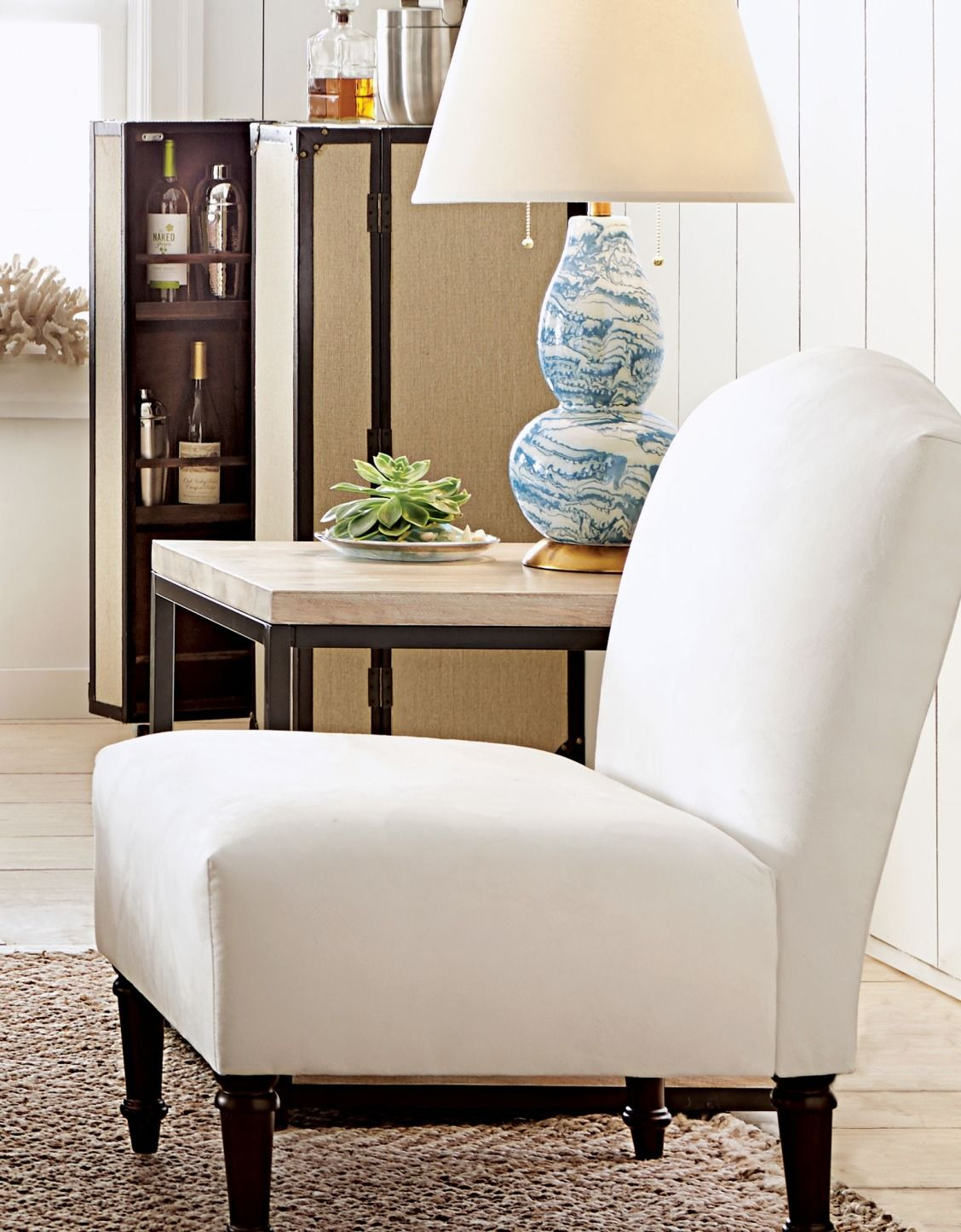 armless accent chair with ottoman
