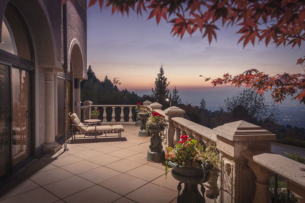 Over 3,000 square feet of deck space on 7 stone-tiled balconies, mindfully placed throughout the home, allows the landscape's beauty to permeate every room. #Balcony #UtahHomes #OutdoorLiving #OutdoorSpace #Deck #UtahSunset #UtahLiving #LuxuryLiving #Luxury #DreamHome #TuscanInspired #HomeDesign #HomeDecor #ExteriorDesign #Landscaping