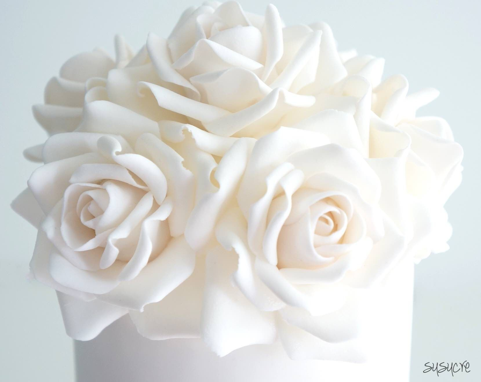 White Rose Wedding Cake With Lots Of Sugar Roses And Flower Topper Perfect For