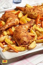 Photo of Chicken legs with vegetables from a tray Everything on a tray …