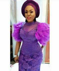 Lady In Beautiful Purple High Neck Beaded Top With Feather Sleeves, Matching Lace Skirt and Gele | Clipkulture #afrikanischemode