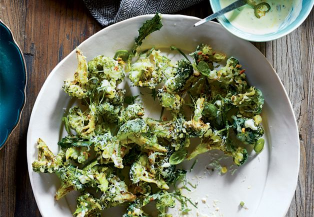 broccoli fritto is deep-fried to glassy perfection and topped with spicy aioli, basil, and a small mountain of grated Parmigiano- Reggiano