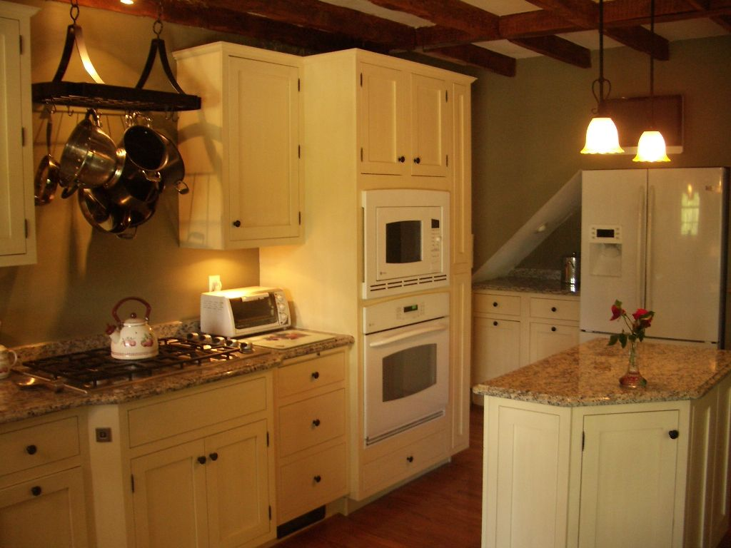 Yellow painted painted kitchen, full