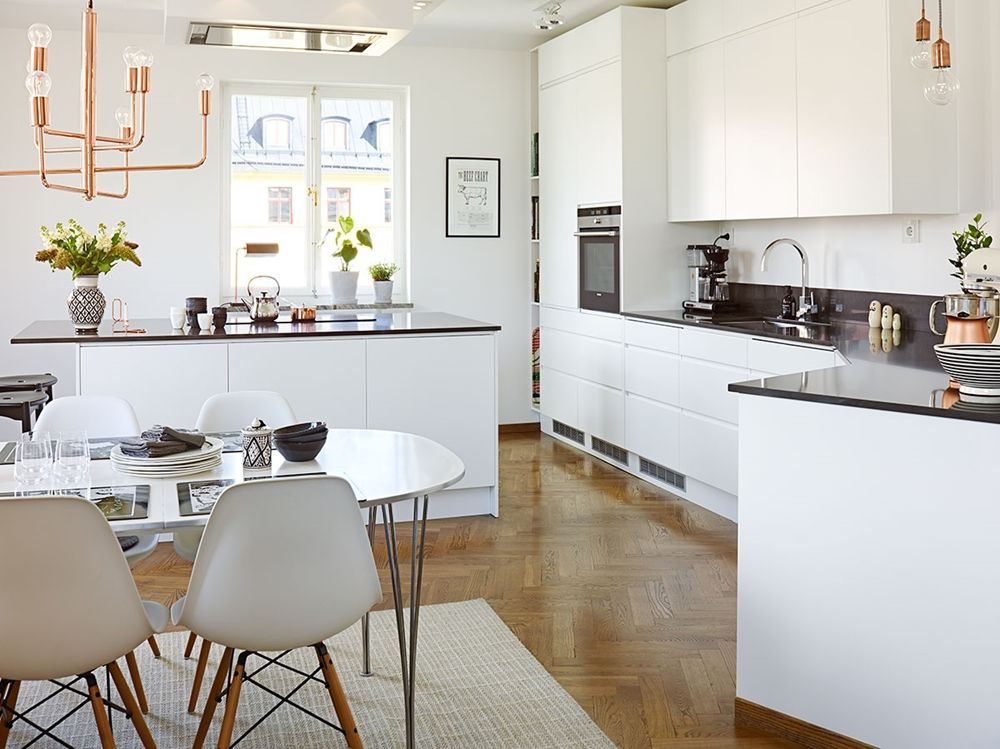 Marvelous Captivating Open Floor Apartment Kitchen Design with Matte Black Kitchen Cabinets and Island and Countertops also Black Bar Stools and Black Huge P u