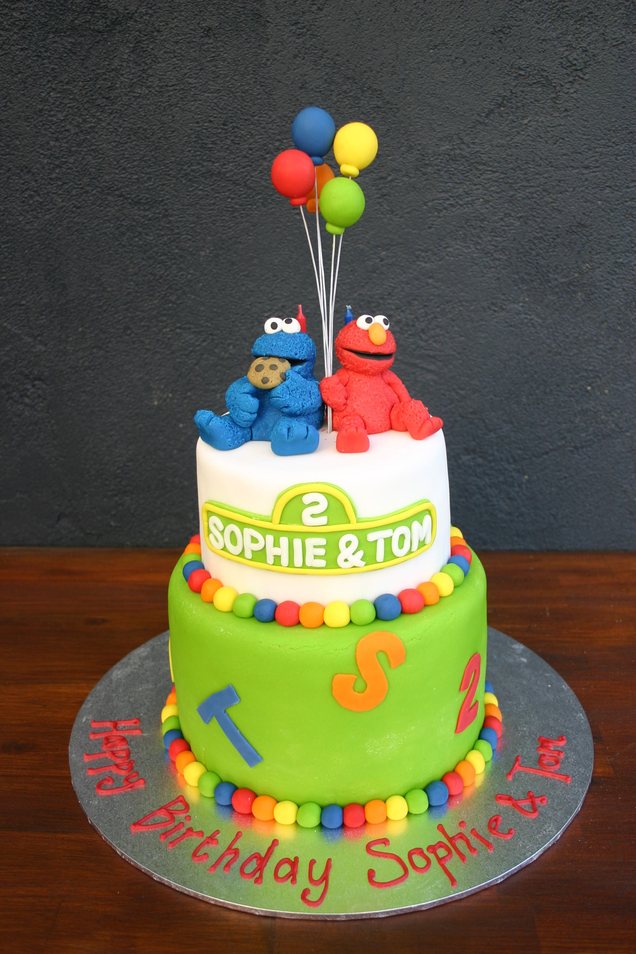 Elmo And Cookie Monster Cake Bottom Tier Is Layered Rainbow Top Chocolate Layer 2 Tiered With Fondant