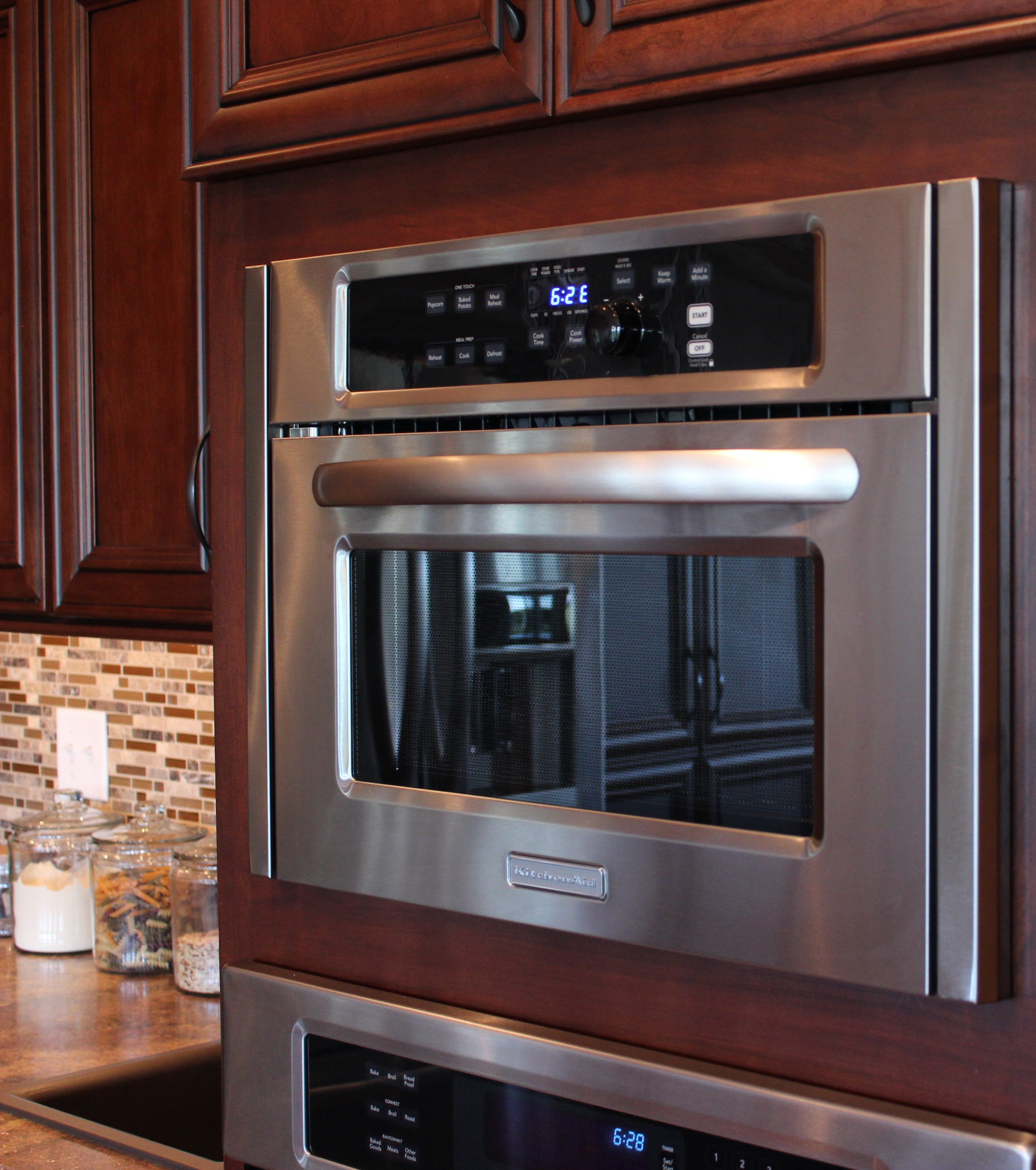 kitchenaid builtin microwave with stainless trim kit to give a custom fit look