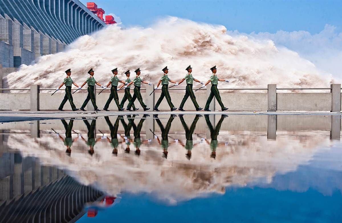Police patrol Three Gorges Dam in China. Dam is at peak flow due to torrential rains along the Yangtze.  The Week in Pictures: msnbc.com