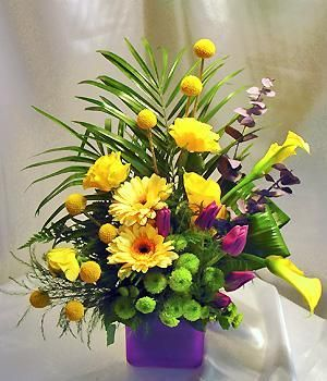 Mixed arrangement with yellow, purple and green flowers