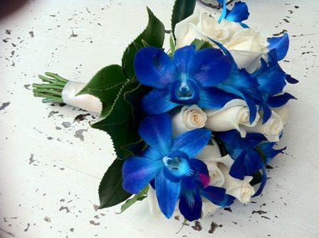 Gorgeous Wedding Bouquet Arranged With: Ivory Roses, Blue Orchids ...