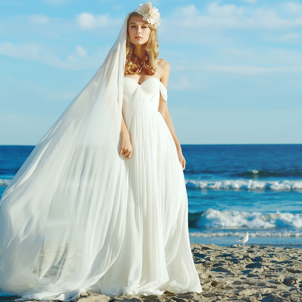 Babe on the beach the gorgeous gown paired with the chiffon veil