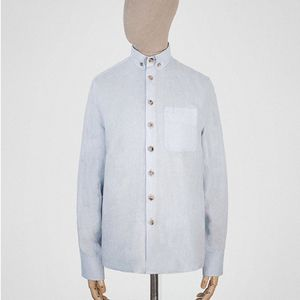 We'd team our Edition 001,  jacquard cashmere sweater vest with Ice-blue linen button-down shirt from SEH KELLY