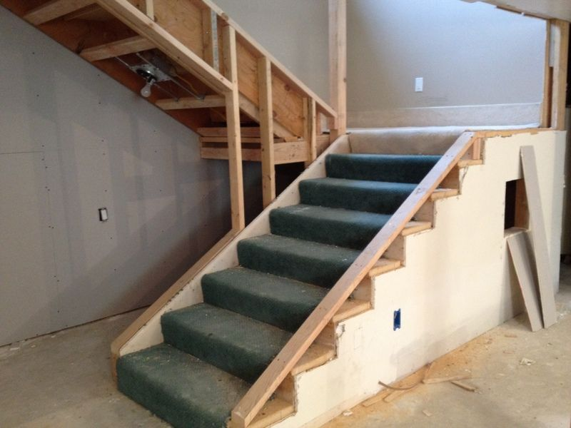 Basement Stairs With Landing. Note The Small Window On The Side For The Play Area Under The Stair Landing