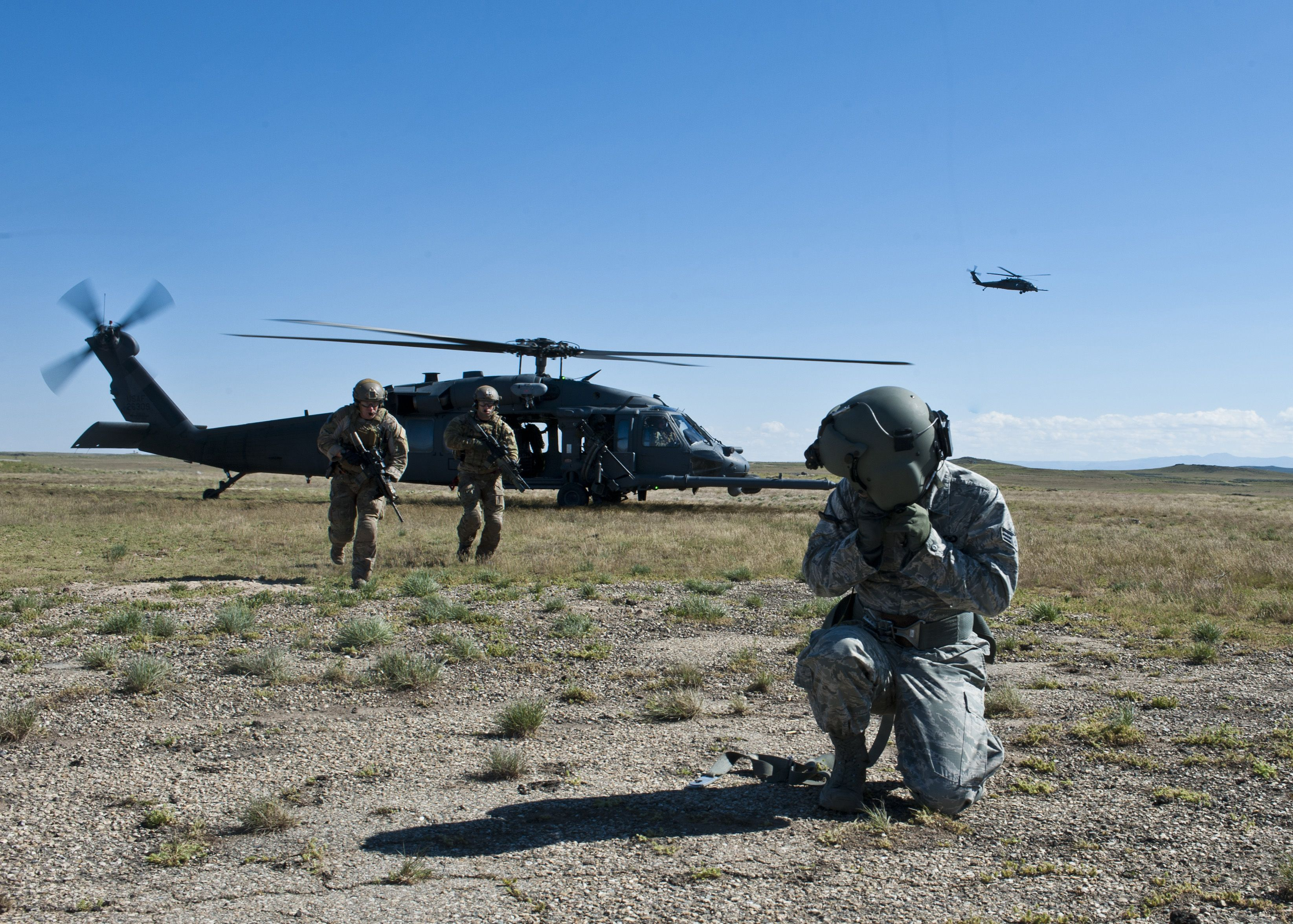 Siklorsky UH-60 Blackhawk. Pararescuemen assigned to the 347th Rescue Group, at Moody Air Force Base, Ga., rescue a simulated survivor during the U.S. Air Force Weapons School April 28, 2014, at Orchard Combat Training Center, Idaho. The Air Force Weapons School encompasses 18 squadrons, teaching 24 weapons instructor courses and 30 combat specialties at eight locations. (U.S. Air Force photo/Senior Airman Jason Couillard)