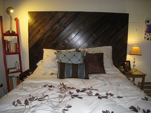 Wood pallet Headboard.  So that I don't fall off the top of my bed.