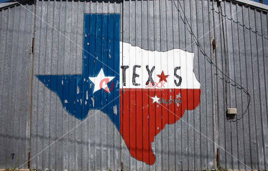 View Of A Rustic And Worn State Texas Lonestar Outline Painting On Barn In