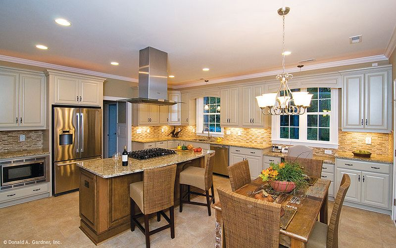Kitchen and single dining space in The Marley, plan 1285. http://www.dongardner.com/plan_details.aspx?pid=4385. #Kitchen #Dining #Design