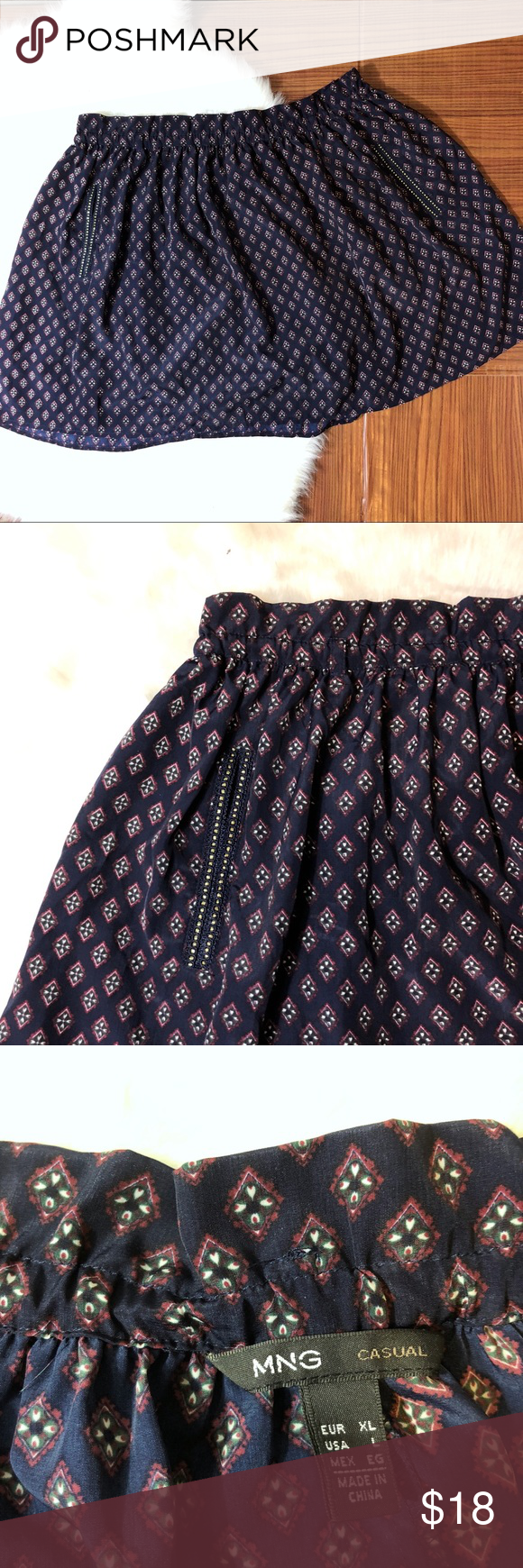900a2bc1b MANGO Navy Geo Flowy Mini Skirt Lightweight flowy mini skirt by MNG (Mango).  2 side front slid pockets lined with embellishment. Waist (across) 17