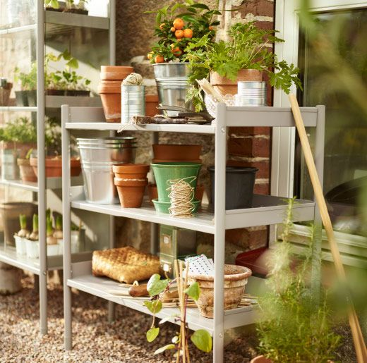 A Backyard With An Outdoor Cabinet With Tempered Glass Doors And A Shelving Unit In Steel Outdoor Shelves Garden Shelves Ikea Outdoor