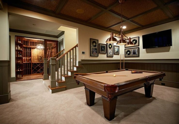 Fabulous basement games room with separate wine cellar for Basement swimming pool ideas