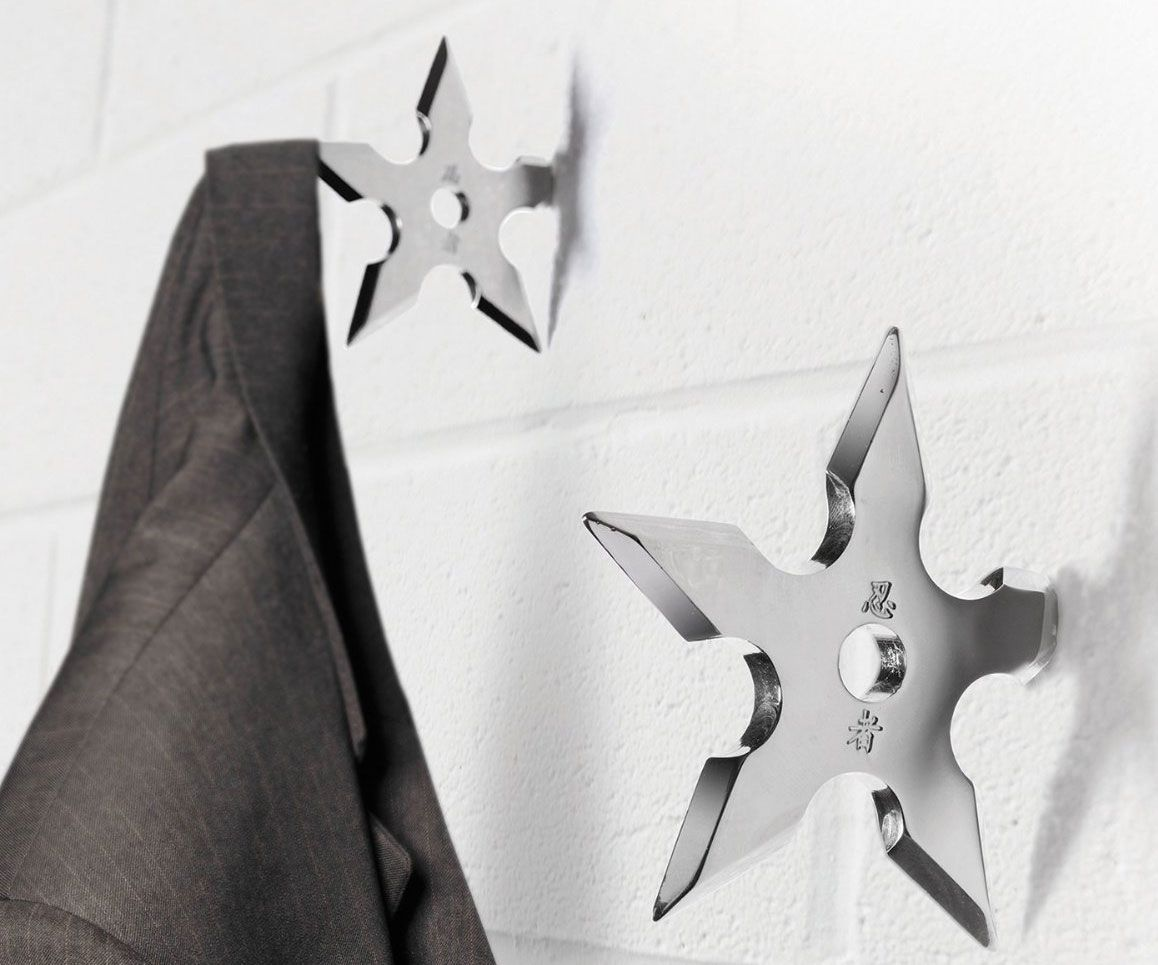 a great gift for badass ninjas these realistic looking throwing stars are actually coat hangers - Stylish Wall Hooks