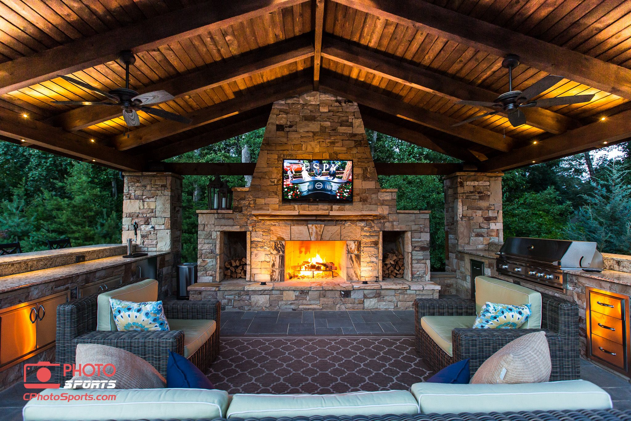 A pavilion with an outdoor kitchen, fireplace and an ... on Covered Outdoor Kitchen With Fireplace id=18451