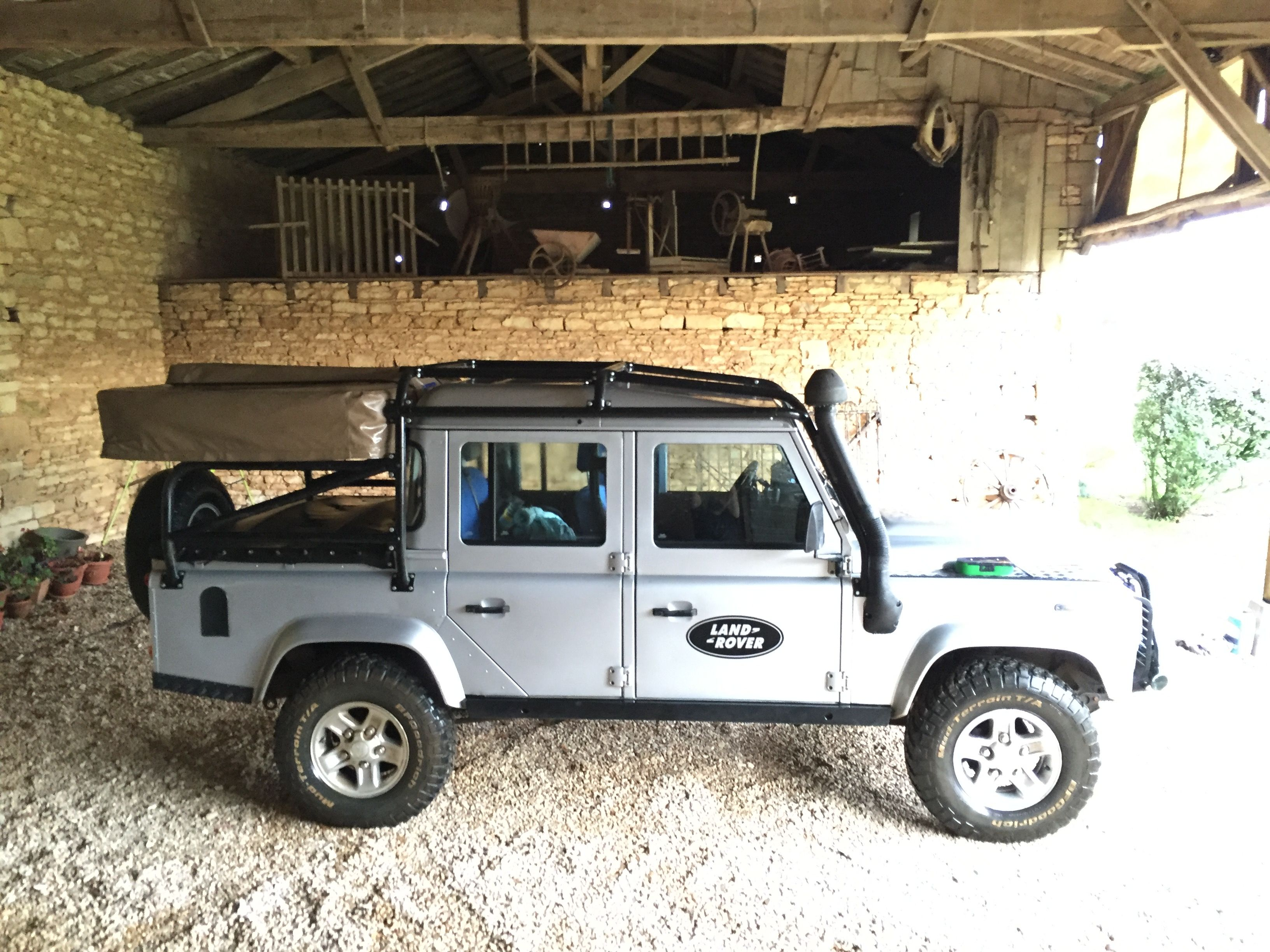 Land Rover Defender With Custom Roll Cage For Roof Tent Land