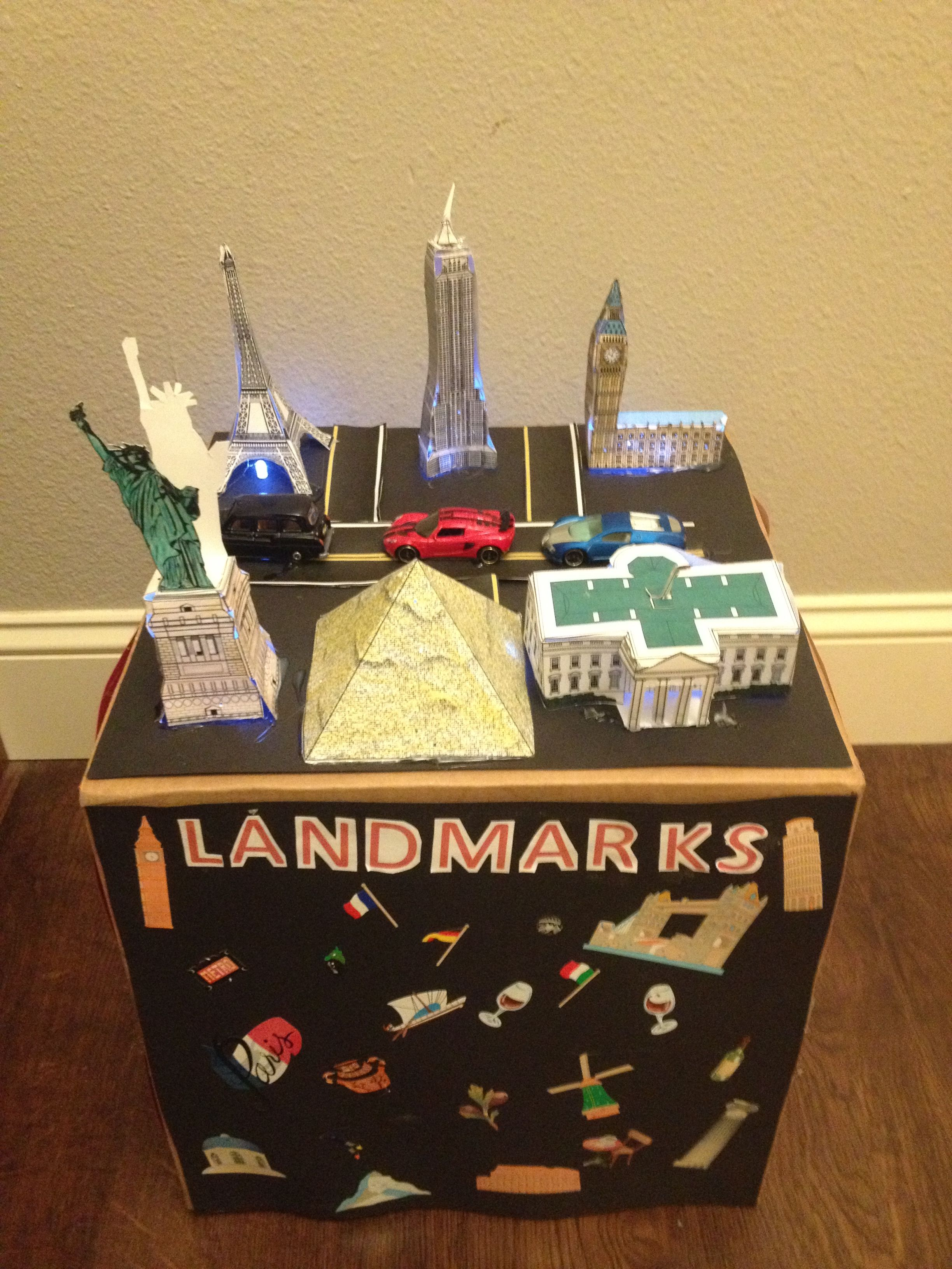 Tanner's fun Valentine box!  He put battery-operated lights in all the landmarks.  Totally his vision- he'd love to see the world.  We found the landmarks on papertoys.com.