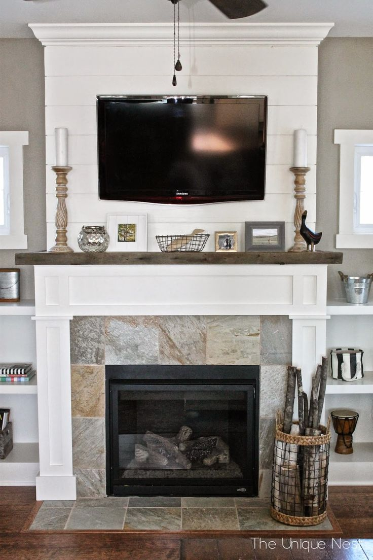 Shiplap fireplace with reclaimed wood mantle and builtins