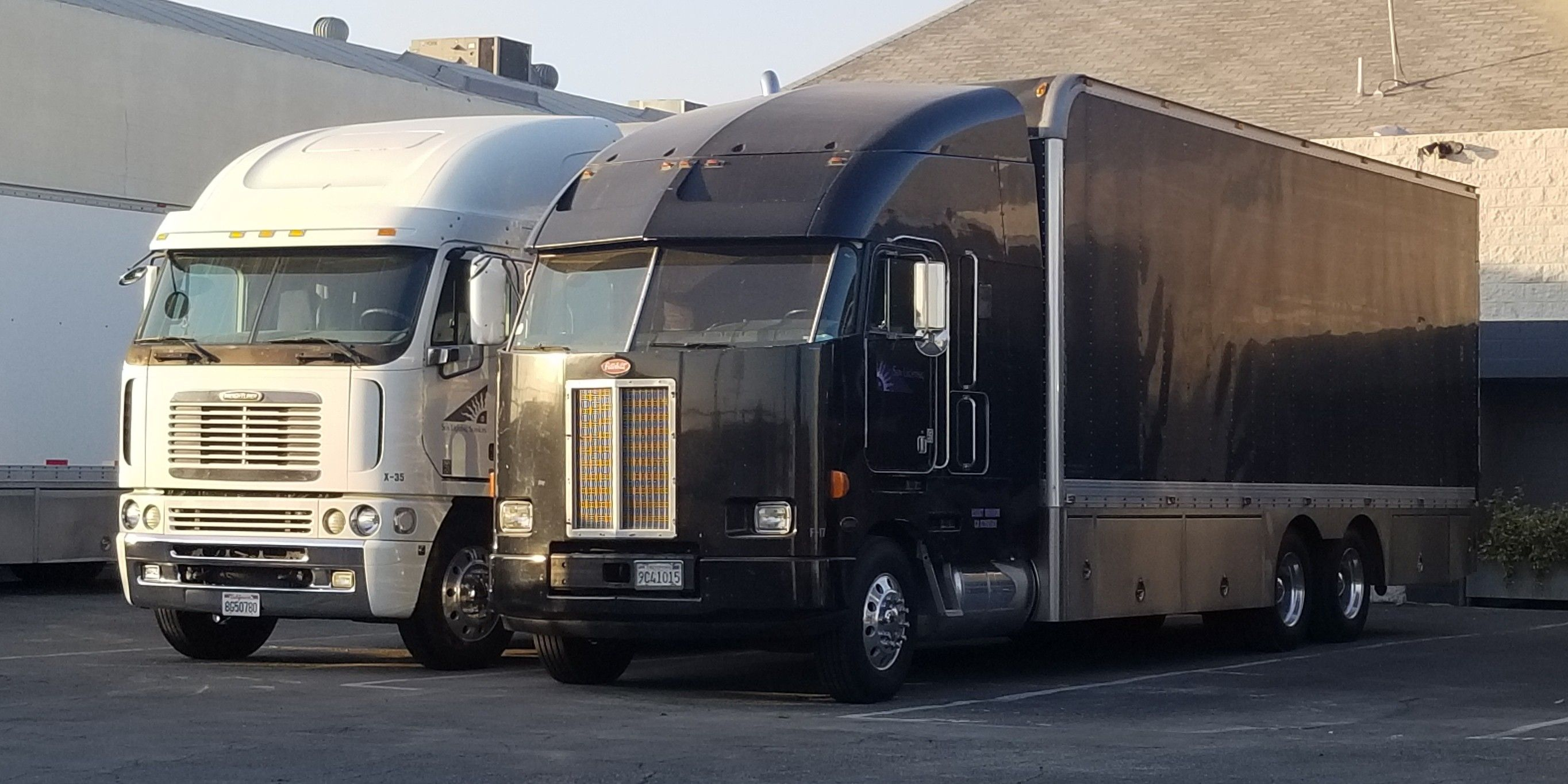 Freightliner agrosy next to a peterbilt 372 football