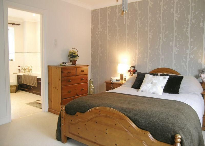 Photo of beige grey pine bedroom with feature wall for Wallpaper for bedroom walls