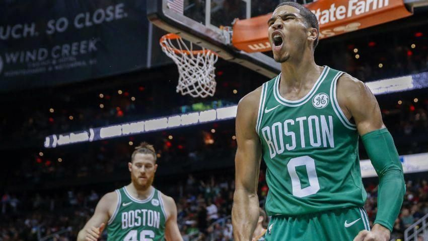 Boston Celtics forward Jayson Tatum reacts after performing a dunk against  the Atlanta Hawks during the second half of the NBA basketball game between  the ... ec462aca9