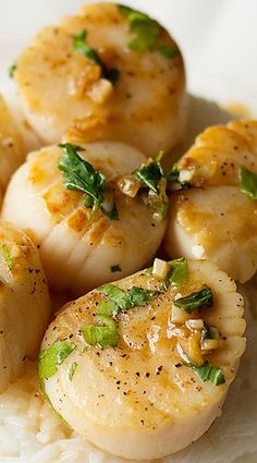 Portuguese Scallops with lemon, garlic and port wine reduction sauce, served with cooked rice.