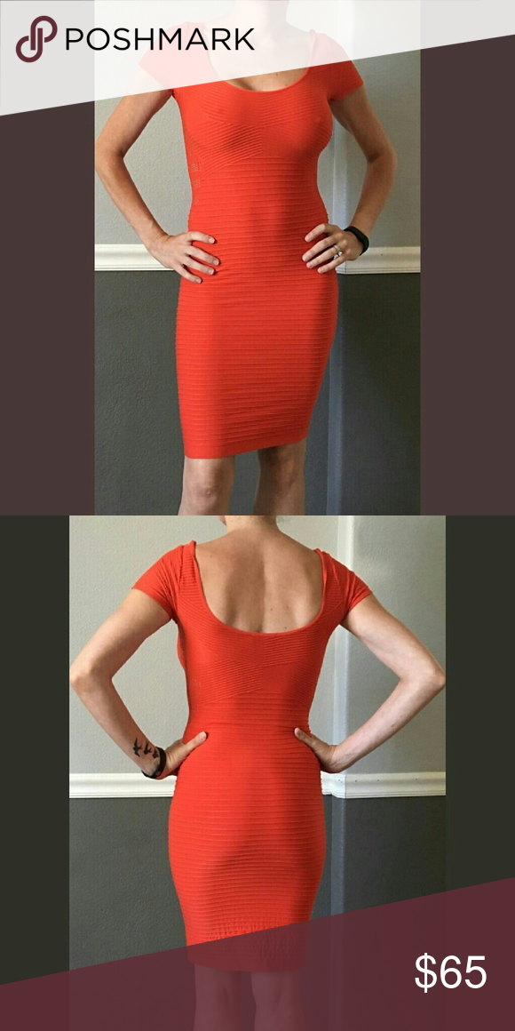 Orange Bebe bodycon dress size 2 Orange Bebe bodycon dress. Size is labeled a M/L. I normally wear a size 2. You can see the fit on my body in the pictures. It is made out of a spandex type material that allows for stretch. Photos are unfiltered and true to color. bebe Dresses Midi