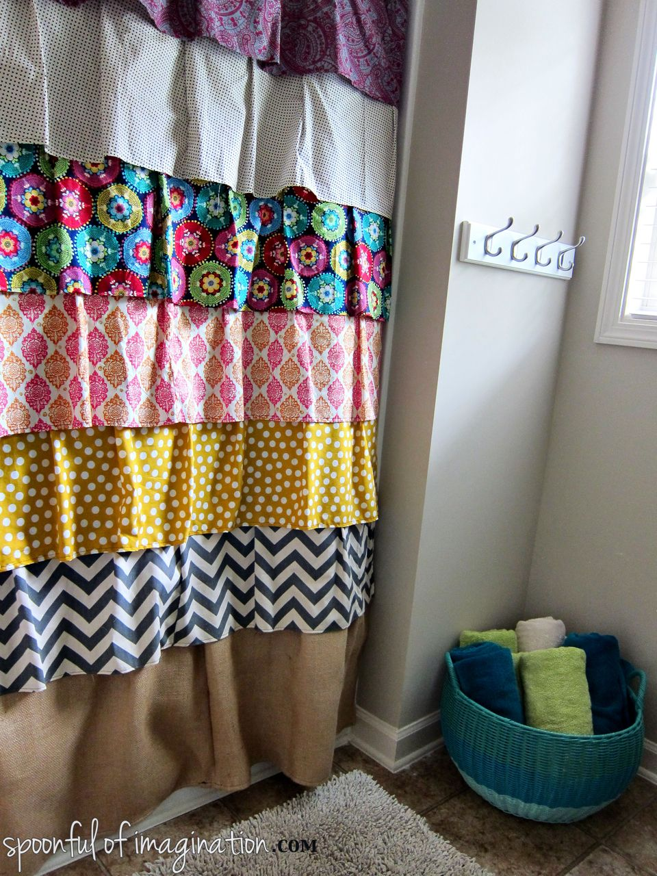 I made this ruffled shower curtain from a bunch of fabrics that ...