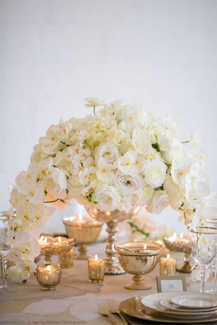 Tall and elegant centerpiece in white silk florals with silver decor ...