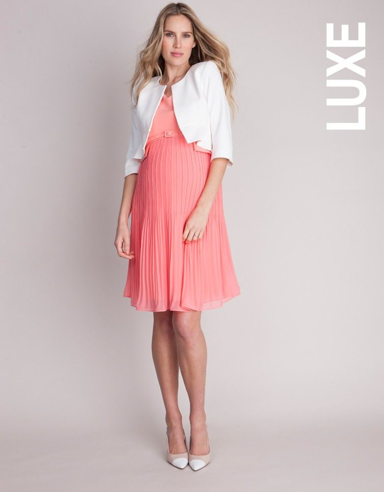 cc753633f8 Seraphine s signature pleated maternity dress is a smart style in a fresh  coral shade - perfect for before