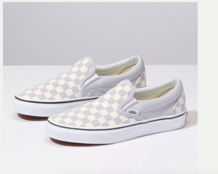all white checkered slip on vans