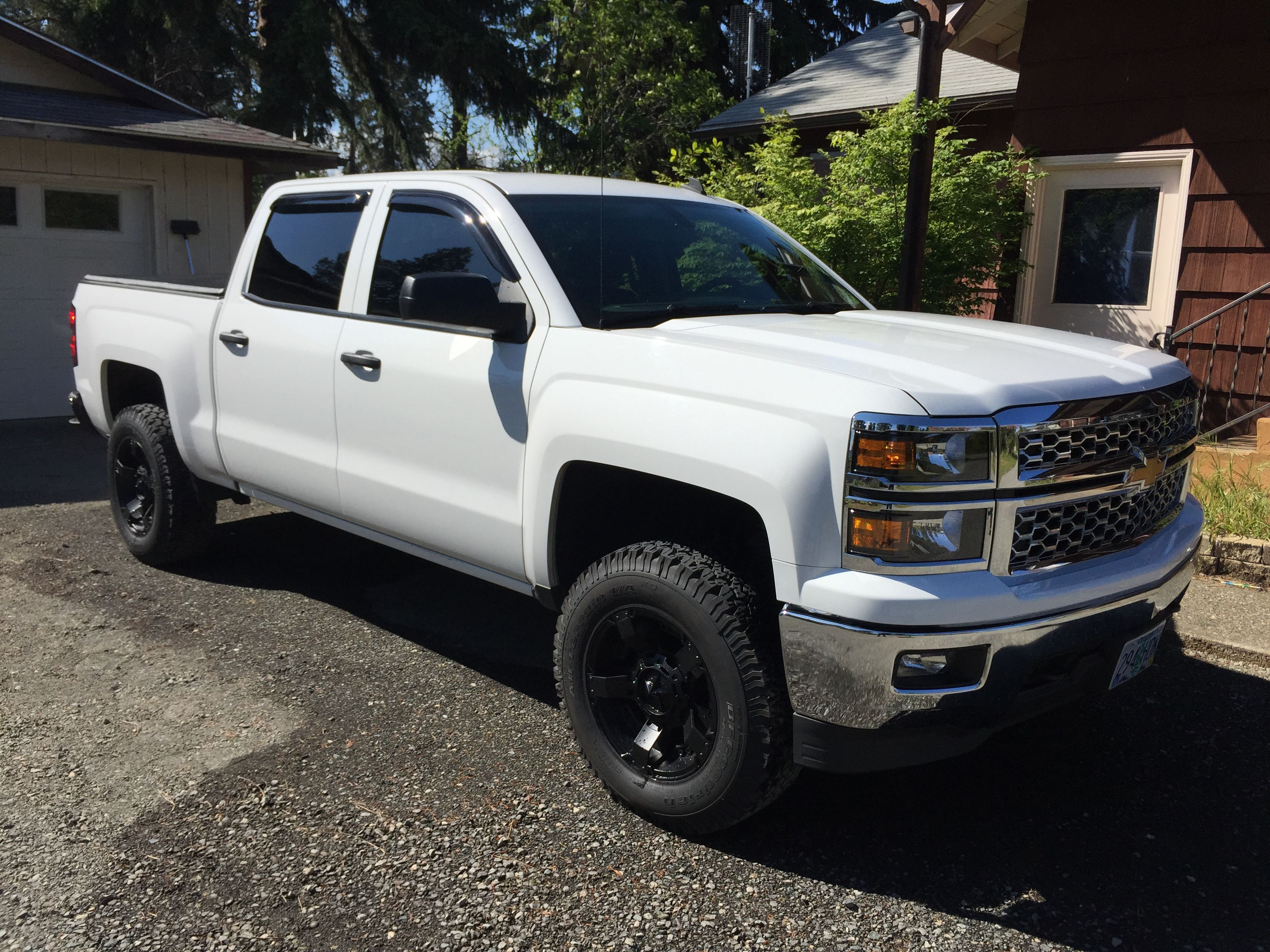 Added rock star ll wheels and bfg all terrain tires 2014 chevychevy