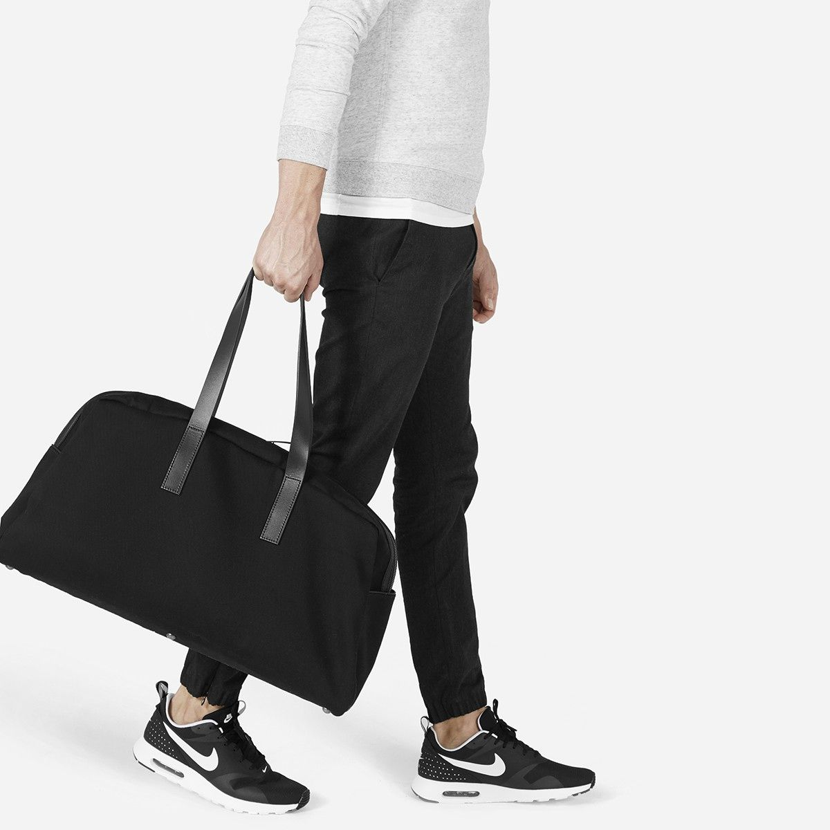 The perfect carry-on upgraded with a beautiful, sturdy twill fabrication 100% water-resistant cotton twill exterior Leather straps and gunmetal feet Spot clean only