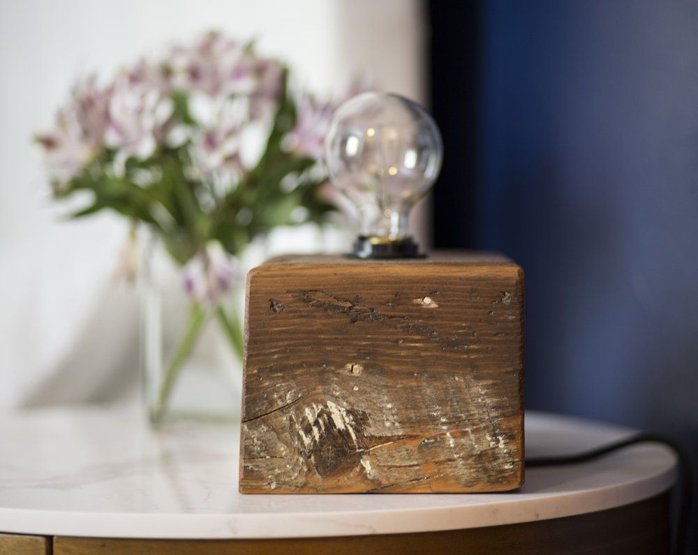 Reclaimed Wood Edison Bulb Block Light This item is made from a solid block of reclaimed wood and features a single Edison bulb light which is controlled by a toggle switch on the cord. This one of a kind piece provides a vintage and rustic look with a modern flare.
