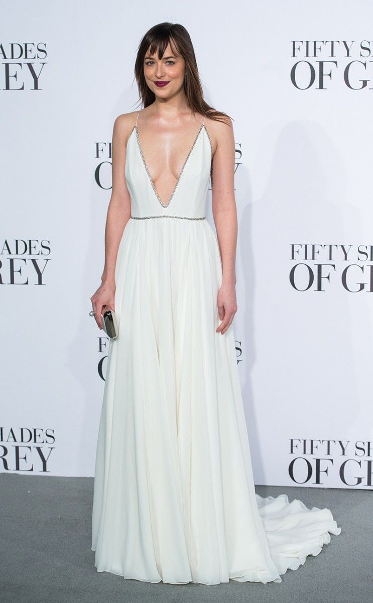 ce4302ab6 Dakota Johnson wears a white Saint Laurent gown to the UK premiere of  Fifter Shades of Grey | See this week's top 10 best dressed celebs