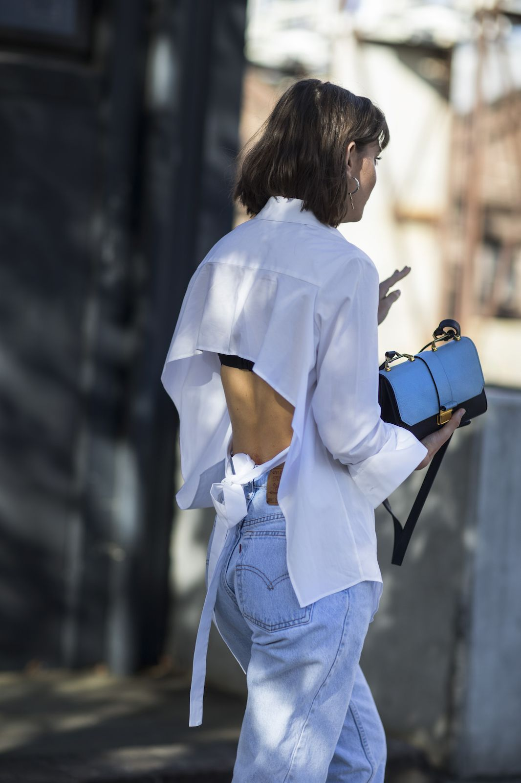 See All The Best Street Style From Fashion Week Down Under #refinery29 http://www.refinery29.com/2016/05/111596/sydney-fashion-week-resort-2016-street-style-pictures#slide-5 Feel the breeze in an open-backed blouse....
