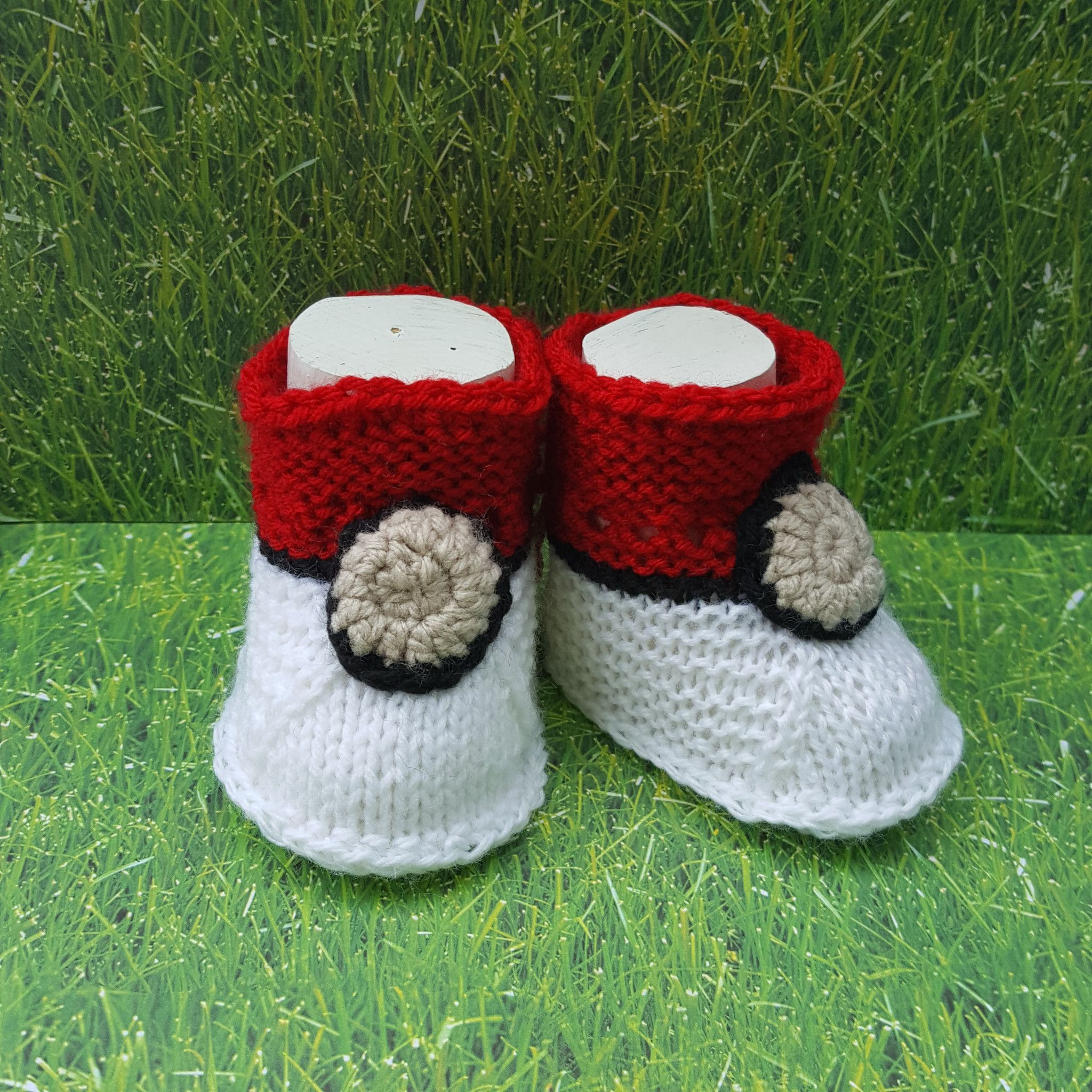 Knitted baby booties Pokemon Go yarn crafty fun