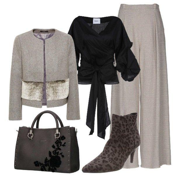 Look chic, composto da cappotto grigio con eco pelliccia