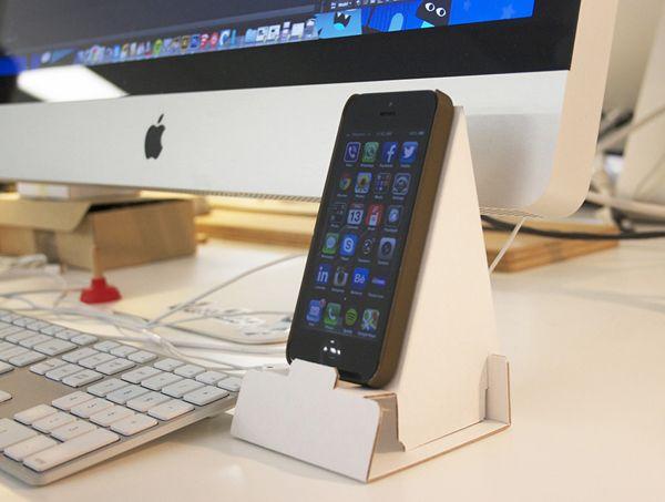 Promo desktop phone holder by Mat Bogust, via Behance
