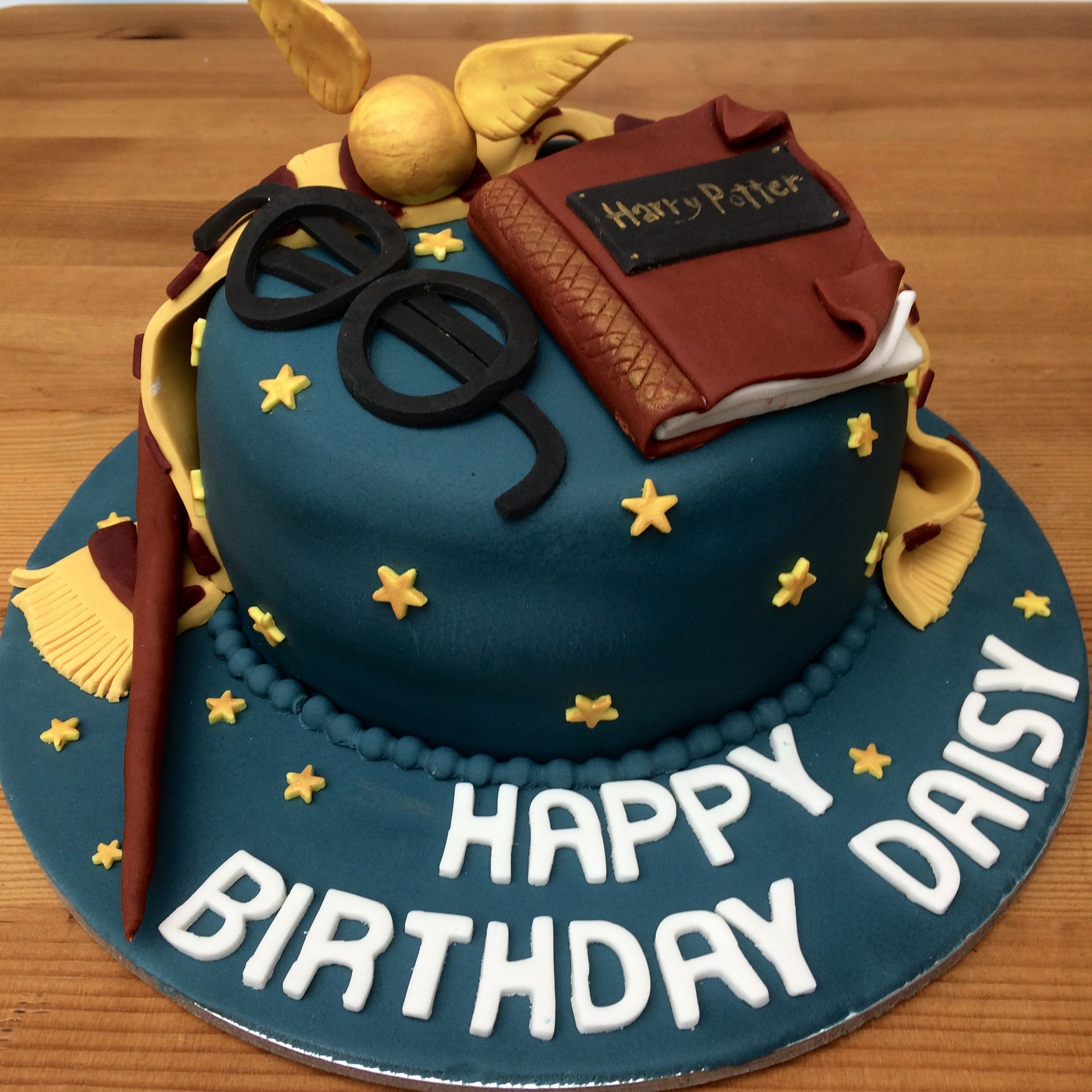 Harry Potter birthday celebration cake with wand spell book