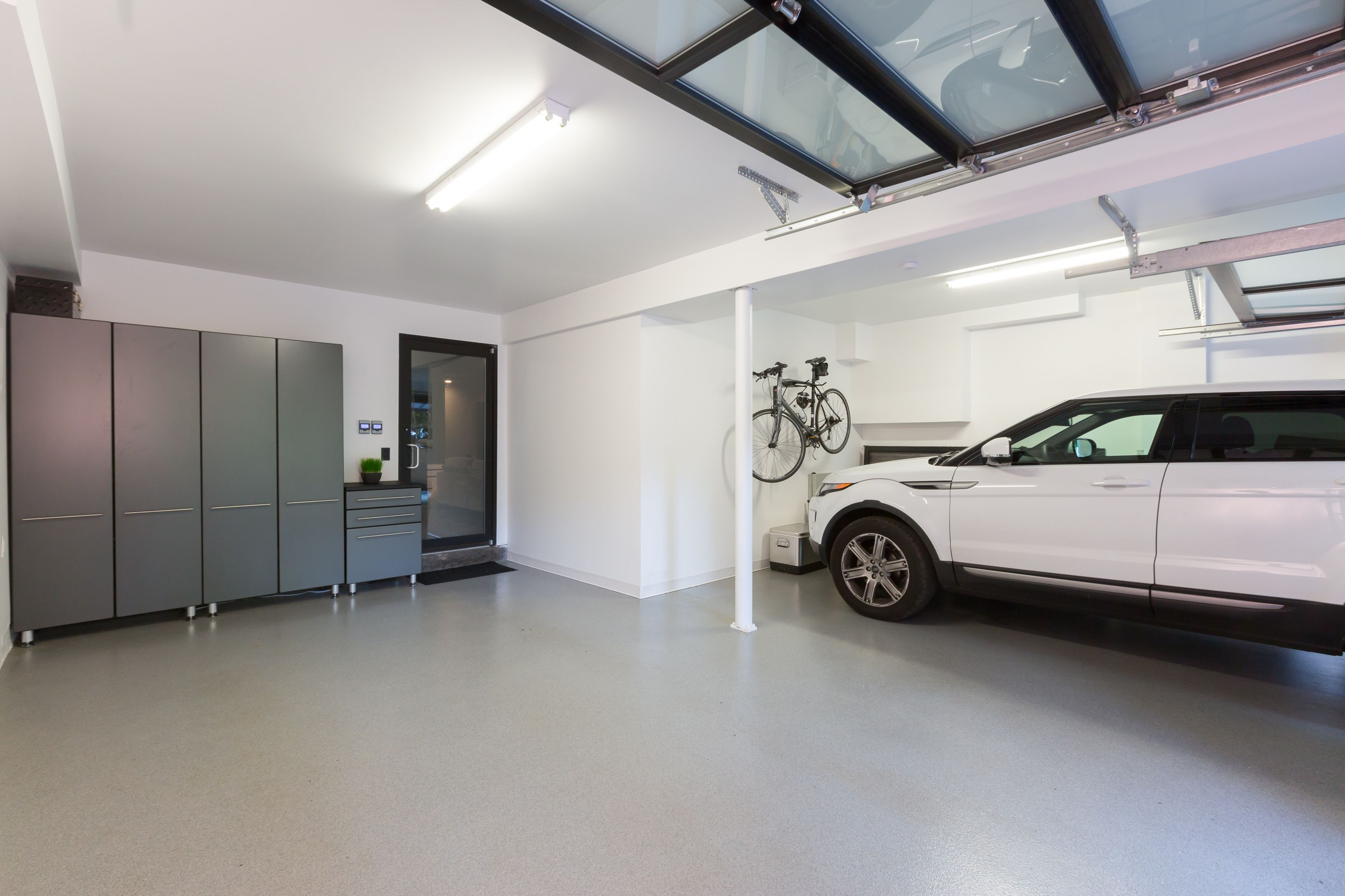 modern two car show garage with epoxy floor frosted glass garage car garage