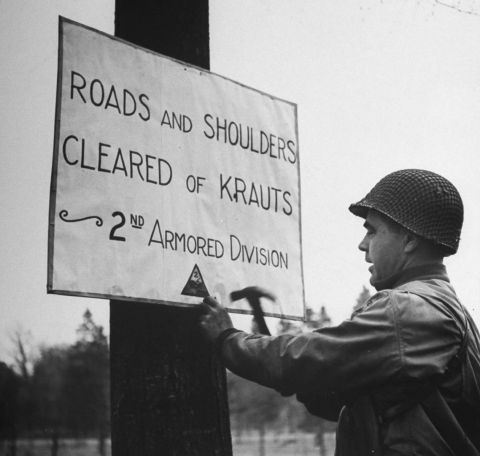 """""""Roads and shoulders cleared of krauts - 2nd Armored Division"""" (Allied drive towards Berlin, 1945)"""
